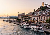 Sunset view of the waterfront of Poros Town, Poros Island, Greece.