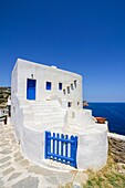 White washed house overlooking the Aegean Sea on Sifnos Island, Cyclades, Greece.