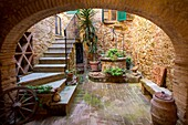 Courtyard entrance to home in Castelmuzio, Tuscany, Italy.