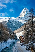 The Vispa River flows below the peak of the Matterhorn through town of Zermatt in the Canton of Valais, Switzerland.