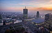 Sunset over Warsaw, Poland. View with Marriott Hotel, Central Railway Station, Golden Terraces mall.