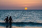 Sunset over Mediterranean Sea seen from the beach in Tel Aviv city, Israel.