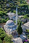 The Hajji Alija Mosque built in 1563 in Pocitelj fortified village over Neretva river, Bosnia and Herzegovina.