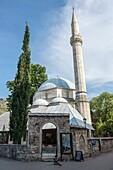 Karagoz Bey Mosque (Karadozbegova dzamija) at Brace Fejica pedestrian street in Mostar city, Bosnia and Herzegovina.