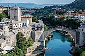 Aerial view on Mostar Old Town and Stari Most (Old Bridge) with Tara Tower over Neretva river, Bosnia and Herzegovina.