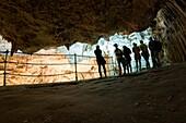 Tourists admire the incredible cave of Neptune. Alghero, Sardinia. Italy.