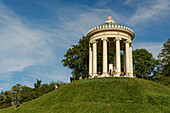 kids playing and visitors at the Monopteros in the Englischer Garten, Munich, Upper Bavaria, Germany