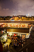 RUSSIA, Moscow. Night view of Bar Strelka located by the Moscow River.