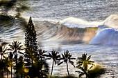 HAWAII, Oahu, North Shore, Eddie Aikau, 2016, locals surfing at Waimea Bay after the Eddie Aikau 2016 surf competition had ended, Waimea Bay