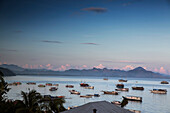 INDONESIA, Flores, boats anchored off the coast of Labuan Bajo at sunrise