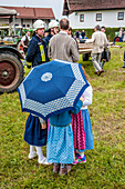 girls with dirndl and umbrella, maypole, bavarian tradition, Bavaria, Germany, Europe