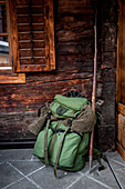 backpack, wooden wall, hunter, ranger, winterly landscape, the Alps, South Tyrol, Trentino, Alto Adige, Italy, Europe