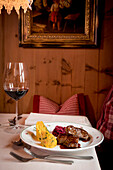 main dish, game, wooden room, traditional decoration, winterly interior, warmness, the Alps, South Tyrol, Trentino, Alto Adige, Italy, Europe