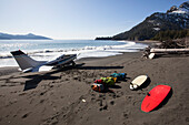 Cessna 206 Landed On The Outer Coast Of Kenai Peninsula Dropping Off Surfers And Gear, Southcentral Alaska, USA