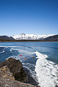 Surfers Along The Kenai Peninsula Outer Coast, Southcentral Alaska, USA