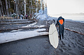 Surfers With Gear By A Campfire During A Surf Trip Near The Gulf Of Alaska, Southcentral Alaska, USA