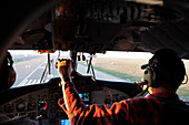View Inside A Cockpit Of A Pilot Landing A De Havilland Twin Otter Dhc-6 At An Airport, Alaska, USA