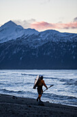 Kayaker Carries Kayak Into Kachemak Bay, Homer Spit, Southcentral Alaska, USA