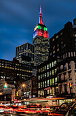 Empire State Building In Christmas And Hanukkah Colours; New York City, New York, United States Of America