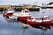 Fishing Boats In The Tranquil Water Of The Harbour; Hofn, Iceland