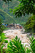 The Town Of Aquas Calientes, Gateway To Machu Picchu, Located In The Andes Mountains With The Rushing Urubamba River; Aguas Calientes, Cuzco, Peru