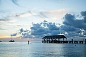 Tourists on Hanalei pier at sunset; Hanalei, Kauai, Hawaii, United States of America; Hanalei, Kauai, Hawaii, United States of America