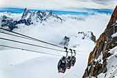 Panoramic Mont Blanc gondola at Aiguille du midi, Aiguille de Rochefort peaks in the background; Chamonix-Mont-Blanc, Haute-Savoie, France