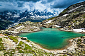 None Lac Blanc, looking towards Mont Blanc Massif and Mer de Glace under dramatic clouds; Chamonix-Mont-Blanc, Haute-Savoie, France