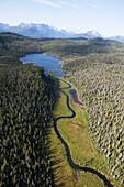 Lake And River In Lake And Peninsula Borough, Aleutian Range In The Distance; Alaska, United States Of America