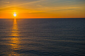 The Golden Setting Sun Illuminated The Horizon And Reflects On The Tranquil Ocean Water; Menton, Cote D'azur, France
