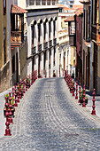 Street Lined With Residential Buildings And Decorative Red Posts In The Historic Part Of Town; La Oratava, Tenerife North, Canary Islands, Spain