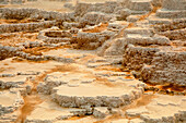 Terraces (Made From Crystallized Calcium Carbonate) Dominate The Landscape At Mammoth Hot Springs, Yellowstone National Park; Wyoming, United States Of America