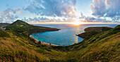 View of Hanauma Bay Nature Preserve at sunrise from the top of the ridge, East Honolulu; Honolulu, Oahu, Hawaii, United States of America