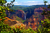 Waimea Canyon Falls and lush foliage on rugged cliffs and mountains; Waimea, Kauai, Hawaii, United States of America