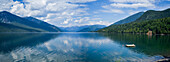 A wooden dock floating in Kootenay Lake in the Selkirk Mountains; Nelson, British Columbia, Canada