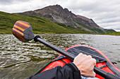 Point of view shot of paddling a pack raft on Landmark Gap Lake near the Denali Highway; Alaska, United States of America