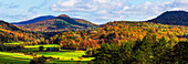 Landscape of forests on the hills with autumn coloured foliage; Iron Hill, Quebec, Canada