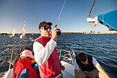 Sailor drinking beer while sailing, Perth, Western Australia, Australia