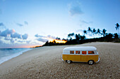 Toy bus at beach during sunrise, north shore of Oahu, Hawaii, USA