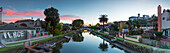 Panorama of one of the famous Venice Beach canals at sunset, Los Angeles, California, USA