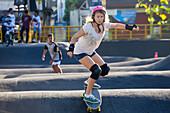 Woman skateboarding in skate park, Canggu, Bali, Indonesia