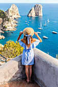 Capri, Naples, Campania, Italy, The cliffs of Capri seen from Belvedere cannone, A girl admiring the view
