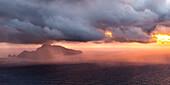 Capri, Napoli, Campania, Italy, Storm over Capri island at sunset