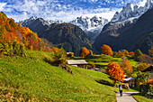 A tourist visit the village of Soglio in the Autumn, Maloja region, Canton of Graubunden, Bregaglia valley, Switzerland, Europe