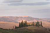 San Quirico d'Orcia, Province of Siena, Orcia Valley, Tuscany, Italy, Europe, View of Podere Belvedere at sunset with Pienza on the background