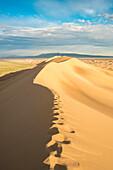 Footsteps on sand dunes in Gobi desert. Sevrei district, South Gobi province, Mongolia.