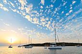 Sailing boats at sunrise (Cala Portese, Caprera Island, Archipelago of La Maddalena National Park, Sassari province, Sardinia, Italy, Europe)