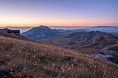 Italy, Abruzzo, Gran Sasso e Monti della Laga National Park, Duca degli Abruzzi mountain hut and plateau Campo Imperatore at sunrise