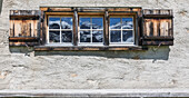 Details of wooden window of a typical alpine house in Davos, Sertig Valley, canton of Graubünden, Switzerland