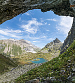 Panoramic of turquoise lake and rocky peaks, Crap Alv Lejets, Albula Pass, canton of Graubünden, Switzerland